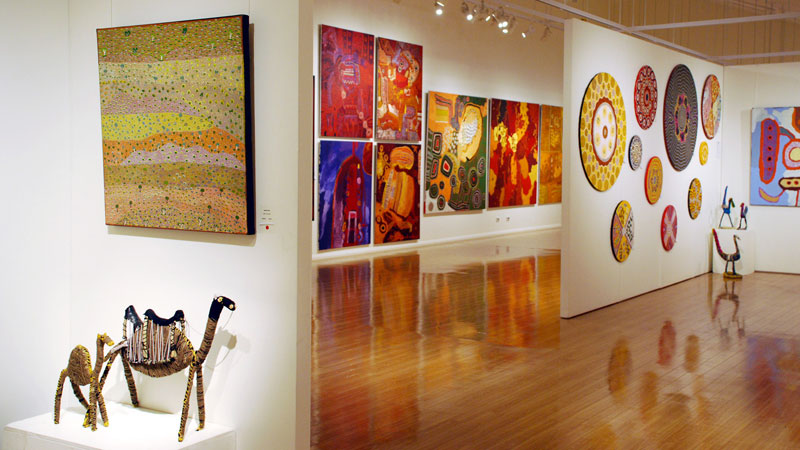 Art gallery full of colorful aboriginal paintings