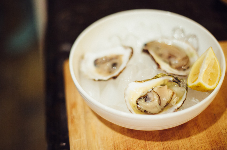 oysters and lemon on an ice bowl