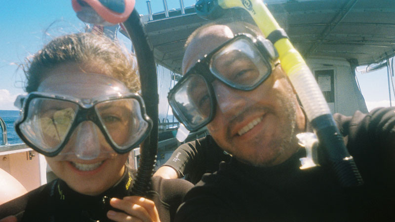 Selfie of a man and a women with snorkeling equipment