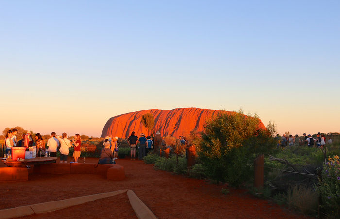 group of people waiting for the sunset in Uluru