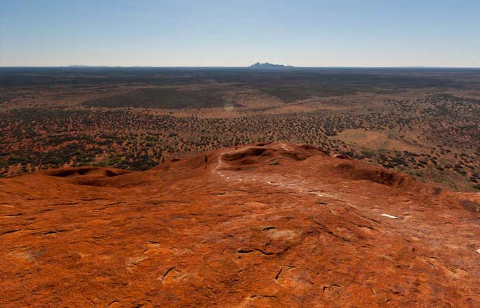 View from the top of Uluru with Kata Tjuta in the background
