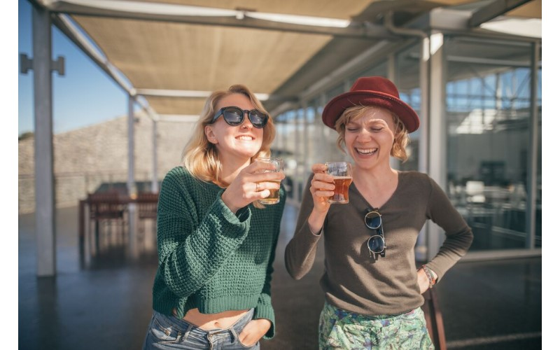Two happy young ladies drinking beer in Tasmania