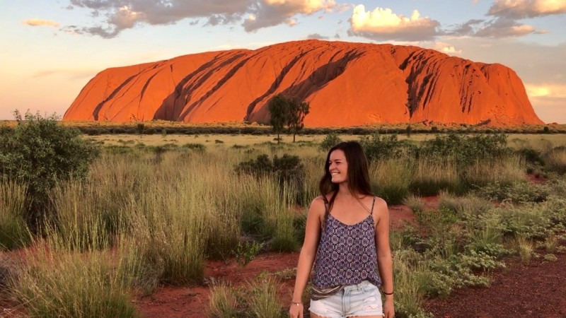 Izzy stands in front of Uluru