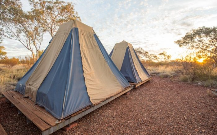 Two brown and blue tents in the outback in Karijini National Park