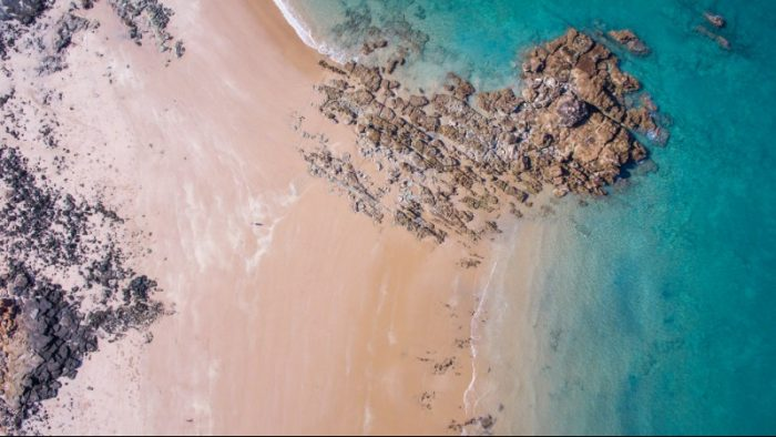 Drone footage from above showing the blue waters in Broome and the sand from above