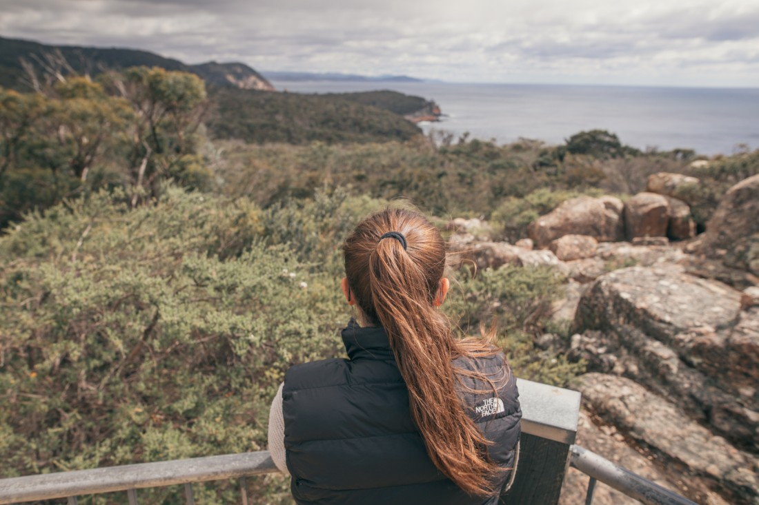 Person overlooking the hills of Tasmania
