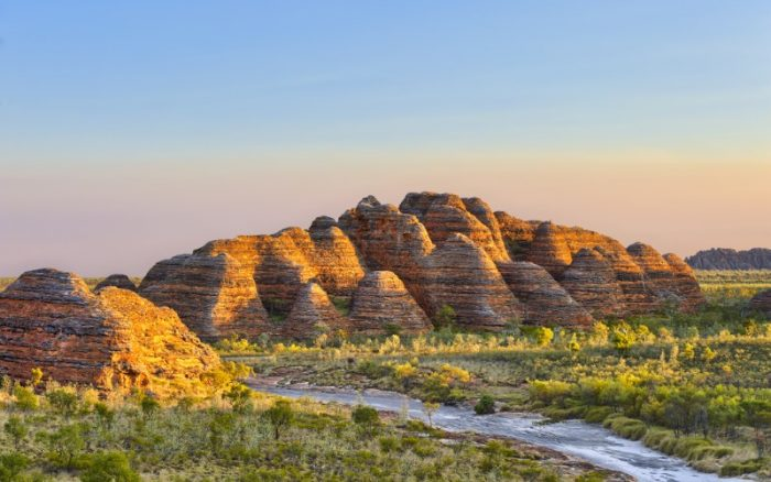 Photo of the Bungle Bungles with a dusky pink sky in the horizon