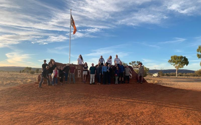 Photo of apround 20 people stnading outside the Alice Springs sing