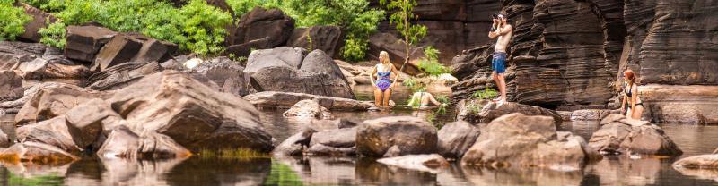 Group swimming at Jim Jim Falls in the Northern Territory