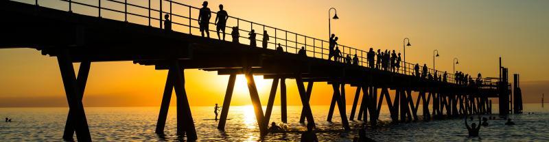 The sun setting over Glenelg Beach in Adelaide