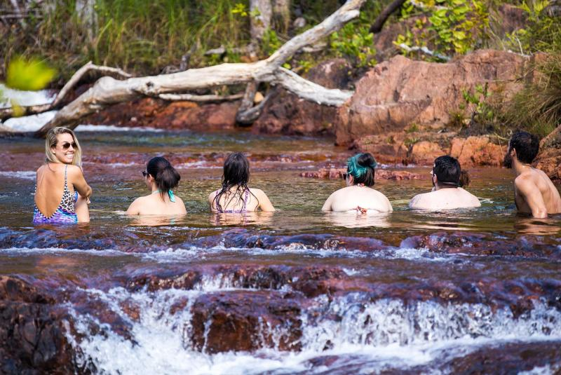 Travellers swimming in Litchfield National Park